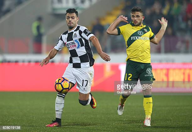 Boavista FC's midfielder Carraca with Pacos Ferreira's midfielder Pedrinho Moreira from Portugal in action during the Primeira Liga match between...