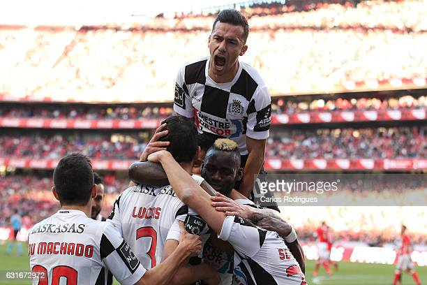 Boavista's defender Lucas Tagliapietra from Brazil celebrates scoring Boavista second goal with his team mates during the match between SL Benfica...