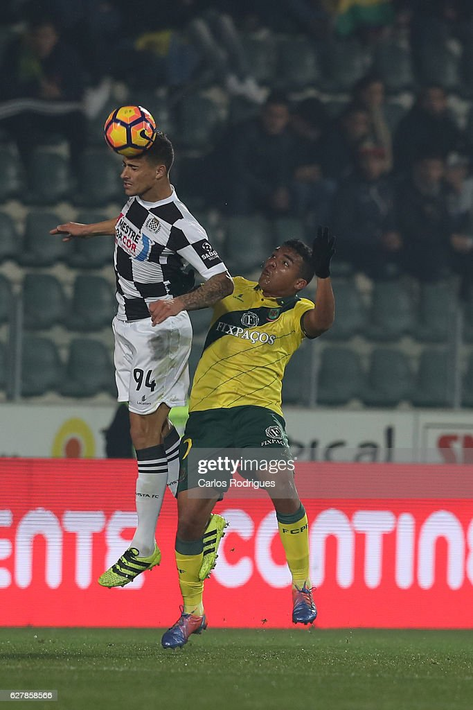 Boavista's defender Philipe Sampaio from Brazil (L) higher that Pacos Ferreira's forward Walton from Brazil (R) heads the ball during the match between FC Pacos de Ferreira and Boavista FC for the Portuguese Primeira Liga at Estadio da Mata Real on December 05, 2016 in Lisbon, Portugal.