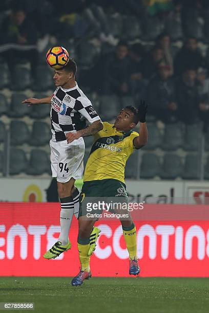 Boavista's defender Philipe Sampaio from Brazil higher that Pacos Ferreira's forward Walton from Brazil heads the ball during the match between FC...