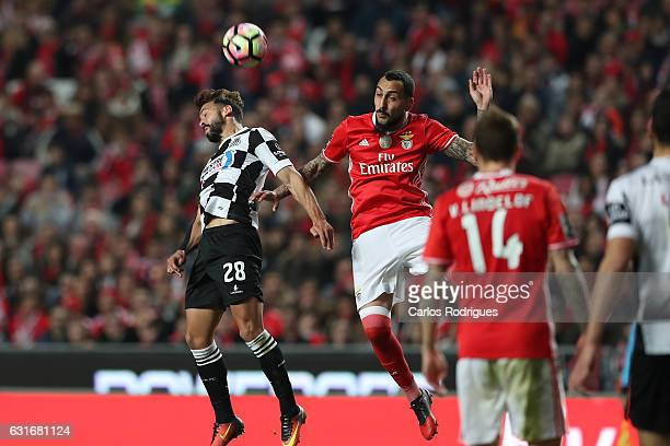 Boavista's defender Tiago Mesquita from Portugal vies with Benfica's forward Kostas Mitroglou from Greece during the match between SL Benfica and...