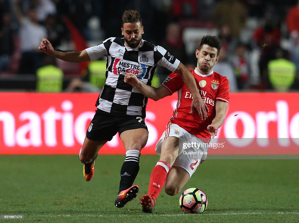 Boavista's defender Tiago Mesquita from Portugal (L) with SL Benfica's midfielder Pizzi (R) in action during the Primeira Liga match between SL Benfica and Rio Ave FC at Estadio da Luz on January 14, 2017 in Lisbon, Portugal.