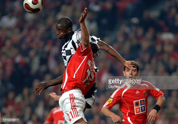 Boavista's Essame and Benfica's Nuno Gomes battle for the ball during Portugese League play Lisbon Portugal February 3 2007
