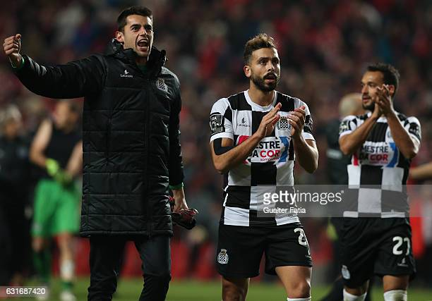 Boavista's goalkeeper Mickael Meira from Portugal and Boavista's defender Tiago Mesquita from Portugal celebrate the draw with supporters at the end...