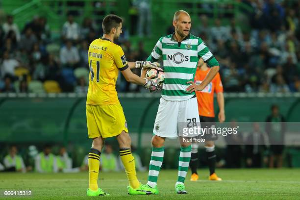 Boavista's goalkeeper Mickael Meira from Portugal and Sportings forward Bas Dost from Holland during Premier League 2016/17 match between Sporting CP...