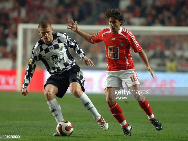 Boavista's Kazmierczak battles for the ball with Benfica's Rui Costa during Portugese League play Lisbon Portugal February 3 2007