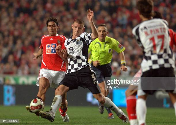 Boavista's Kazmierczak battles with Benfica's Rui Costa for the ball during Portugese League play Lisbon Portugal February 3 2007