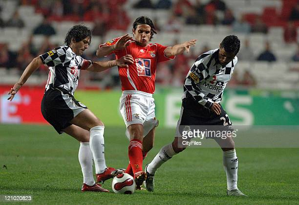 Boavista's Lucas Tiago and Benfica's Nuno Gomes battle for the ball during Portugese League play Lisbon Portugal February 3 2007