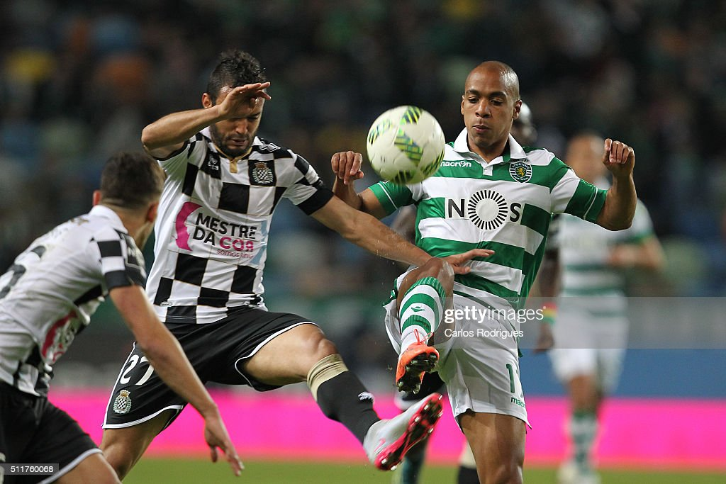 Boavista's midfielder Anderson Carvalho (L) vies with Sporting's midfielder Joao Mario (D) during the match between Sporting CP and Boavista FC for the Portuguese Primeira Liga at Jose Alvalade Stadium on February 22, 2016 in Lisbon, Portugal.
