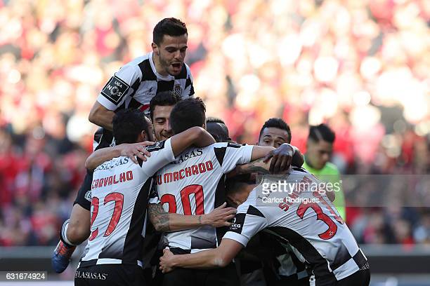 Boavista's midfielder Andre Schembri from Malta celebrates scoring Boavista third goal with his team mates during the match between SL Benfica and...