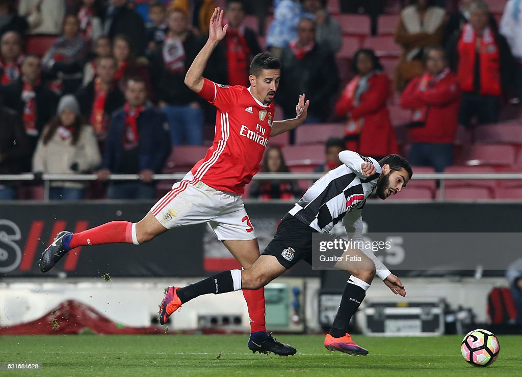 Boavista's midfielder Emin Makhmudov from Azerbaijan (R) with SL Benfica's defender Andre Almeida (L) in action during the Primeira Liga match between SL Benfica and Rio Ave FC at Estadio da Luz on January 14, 2017 in Lisbon, Portugal.
