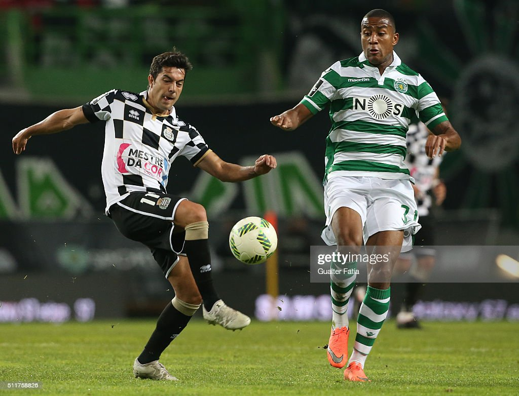 Boavista's midfielder Mario Martinez with Sporting CP's defender Marvin Zeegelaar from Holland in action during the Primeira Liga match between Sporting CP and Boavista at Estadio Jose Alvalade on February 22, 2016 in Lisbon, Portugal.