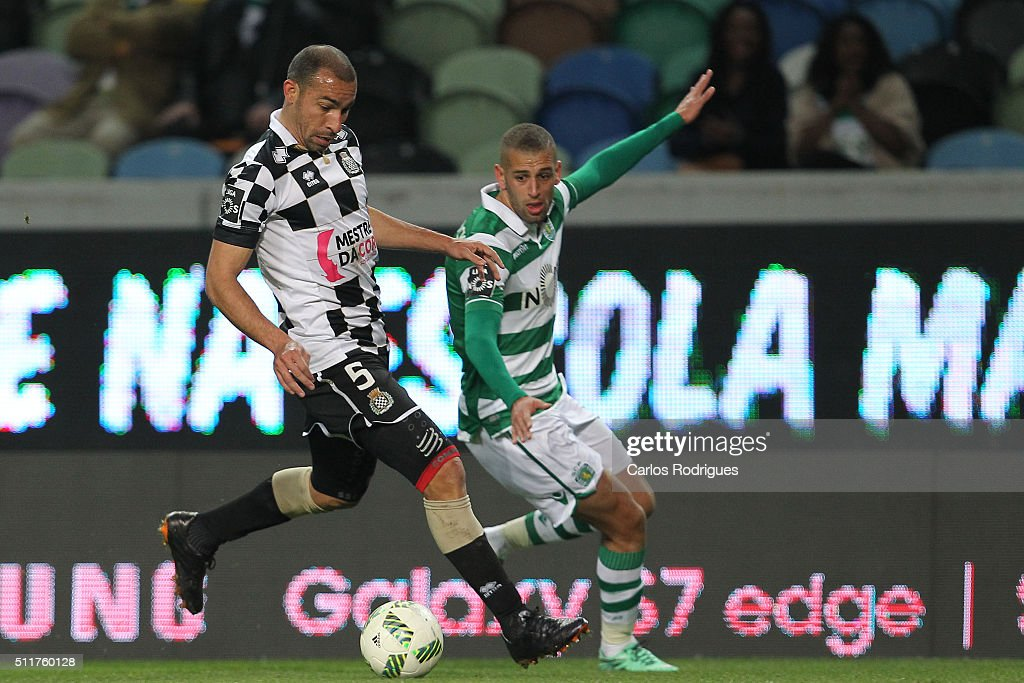 Boavista's midfielder Paulo Vinicius (L) vies with Sporting's forward Islam Slimani (R) during the match between Sporting CP and Boavista FC for the Portuguese Primeira Liga at Jose Alvalade Stadium on February 22, 2016 in Lisbon, Portugal.