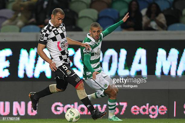 Boavista's midfielder Paulo Vinicius vies with Sporting's forward Islam Slimani during the match between Sporting CP and Boavista FC for the...