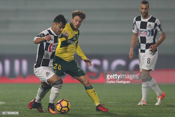 Boavista's midfielder Samu from Portugal vies with Pacos Ferreira's midfielder Andrezinho from Portugal during the match between FC Pacos de Ferreira...