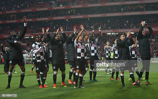 Boavista's players celebrate the draw at the end of the Primeira Liga match between SL Benfica and Rio Ave FC at Estadio da Luz on January 14 2017 in...