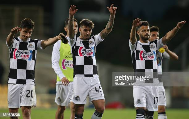 Boavista's players celebrate the draw with supporters at the end of the Primeira Liga match between GD Estoril Praia and Boavista FC at Estadio...