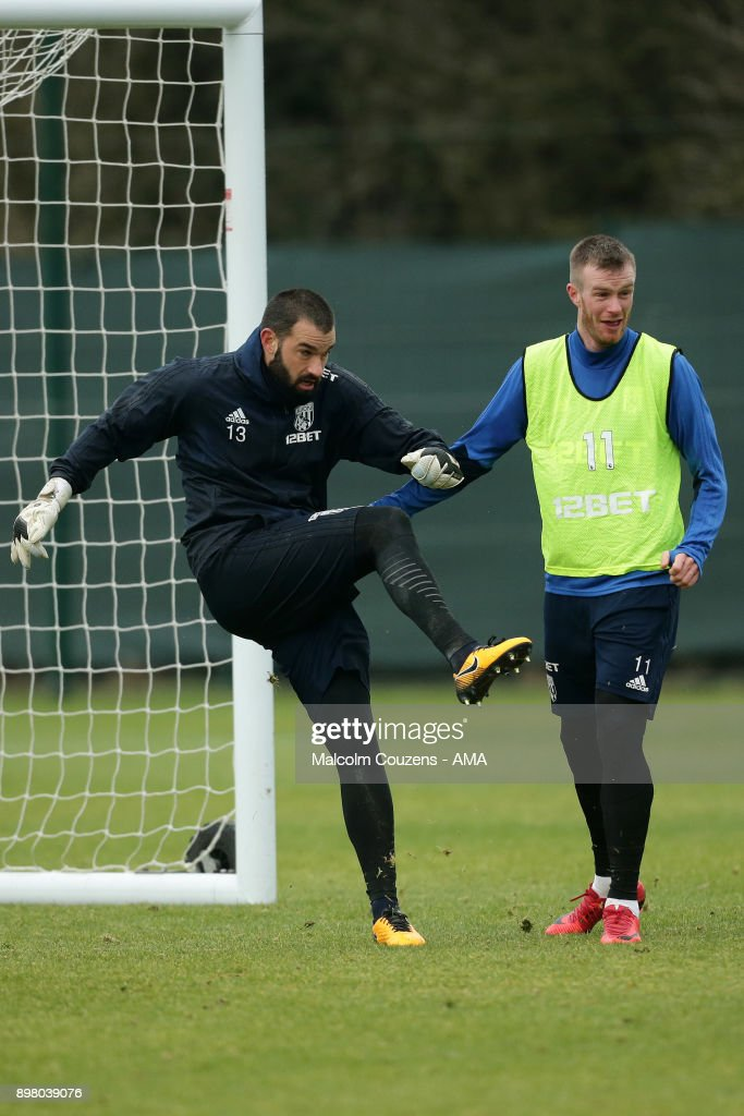 Boaz Myhill and Chris Brunt of West Bromwich Albion on December 19, 2017 in West Bromwich, England.