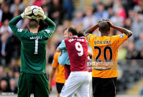 Boaz Myhill and George Boateng of Hull City looks dejected after Burnley's third goal during the Barclays Premier League match between Hull City and...