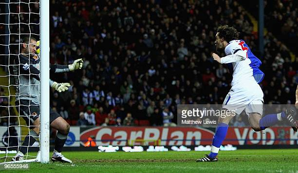 Boaz Myhill of Hull saves a shot from Gael Givet of Blackburn with his head during the Barclays Premier League match between Blackburn Rovers and...