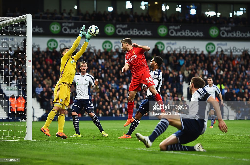 Boaz Myhill of West Brom makes a save Fabio Borini of Liverpool during the Barclays Premier League match between West Bromwich Albion and Liverpool at The Hawthorns on April 25, 2015 in West Bromwich, England.