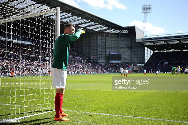 Boaz Myhill of West Bromwich Albion takes a drink wearing his special kit on Jeff Astle Day celebrating the former WBA legend who made his debut...