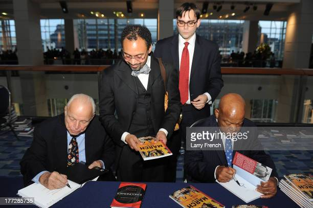 Bob Adelman Dr Rodney Sampson Nate Powell and Congressman John Lewis sign copies of their books at the Emancipation Of Capital Gala And Awards...