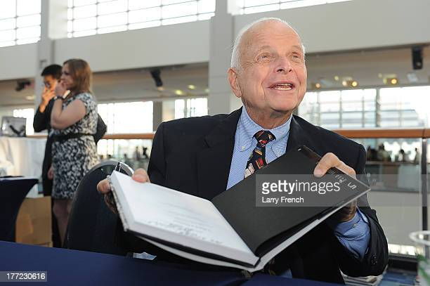 Bob Adelman signs a copy of his book at the Emancipation Of Capital Gala And Awards Ceremony celebrating the 150th Anniversary of the Emancipation...