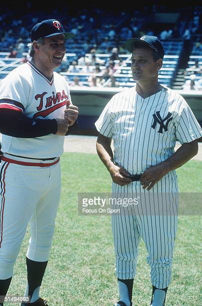 Bob Allison of the Minnesota Twins and Roger Maris of the New York Yankees talk on the field during Old Timers Day at Yankee Stadium on July 22 1984...