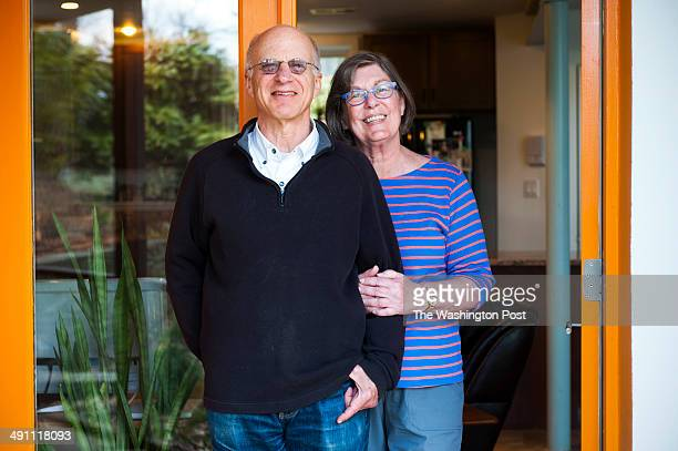 Bob and Carol Schwartz completely gutted the home they bought and dug out the former basement to create their kitchen and dining room and pose for a...