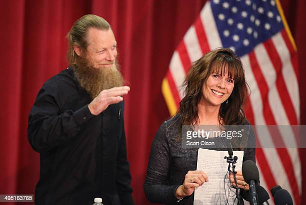 Bob and Jani Bergdahl greet supporters as they arrive at a press conference to address their son Sgt Bowe Bergdahl's release from captivity at Gouen...
