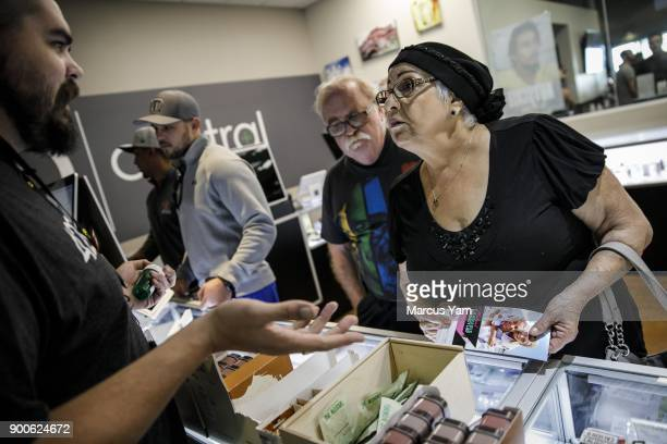 Bob and Judy Malgeri discuss their purchase options with Maxwell Robinson far left at 420 Central in Santa Ana Calif on Jan 1 2018 The state has...