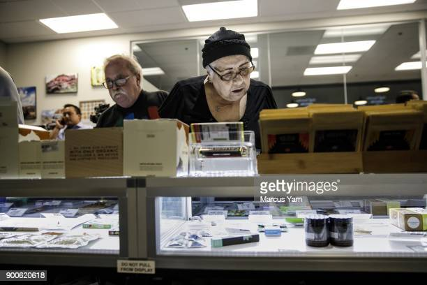 Bob and Judy Malgeri shops around for pot at 420 Central in Santa Ana Calif on Jan 1 2018 The state has issued dozens of permits for retailers to...