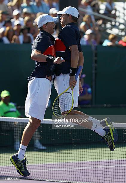 Bob and Mike Bryan celebrate match point against Bernard Tomic and Paul Hanley of Australia in their first round doubles match at the Sony Ericsson...