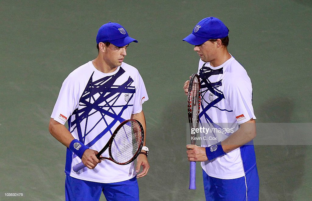 Bob and Mike Bryan converse during their match against Wesley Moodie of South Africa and Dick Norman of Belgium during the semifinals on Day 6 of the Western & Southern Financial Group Masters at the Lindner Family Tennis Center on August 21, 2010 in Cincinnati, Ohio.