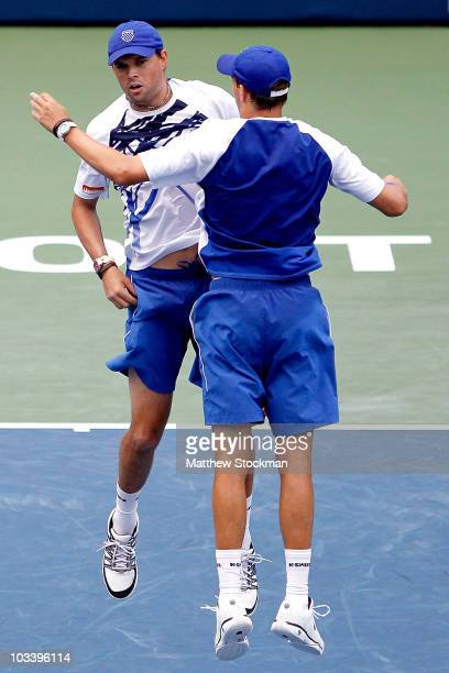 Bob and Mike Bryan of the United States celebrate match point against Michael llodra and Julien Benneteau of France in the doubles during the final...