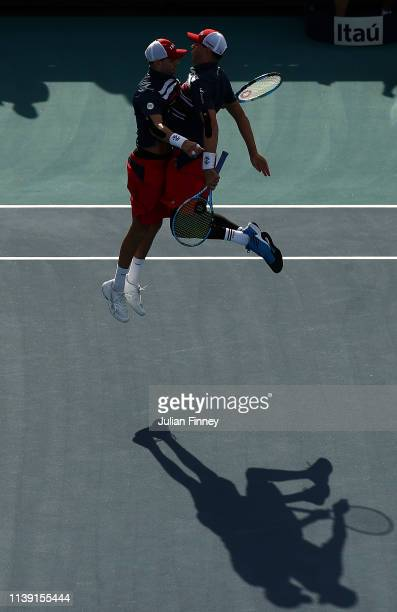 Bob and Mike Bryan of USA celebrate defeating Lukasz Kubot of Poland and Marcelo Melo of Brazil during day twelve of the Miami Open tennis on March...