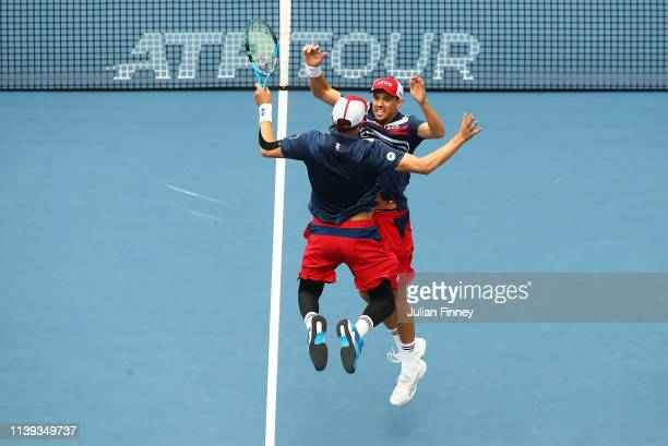 Bob and Mike Bryan of USA celebrate defeating Stefanos Tsitsipas of Greece and Wesley Koolhof of Netherlands in the doubles final during day thirteen...