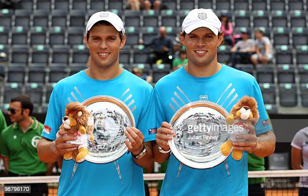 Bob and Mike Bryan of USA with the winners trophies after defeating John Isner and Sam Querrey of USA in the doubles final during day eight of the...