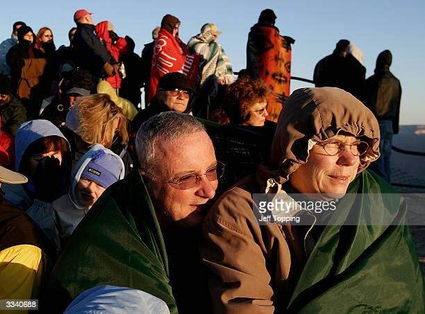 Bob and Sandy Montevaldo of San Mateo California watch the sunrise during Easter service on Mather Point at the south rim of the Grand Canyon in...