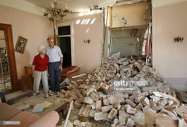 Bob and Wendy Perry from Kinsey Terrace in Sumner look at the damage to their lounge after Christchurch was rocked by a 63 magnatude earthquake on...