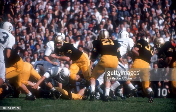 Bob Anderson of the Army Cadets blocks as his teammate Pete Dawkins runs with the ball during an NCAA game against the Penn State Nittany Lions on...
