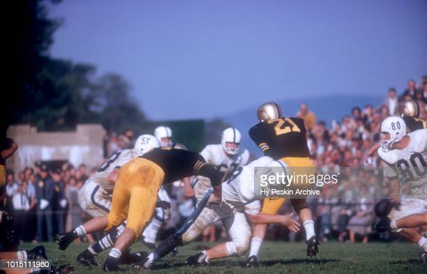 Bob Anderson of the Army Cadets runs with the ball as Andy Stynchula of the Penn State Nittany Lions go for the tackle during an NCAA game on October...