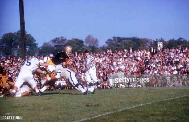 Bob Anderson of the Army Cadets runs with the ball as Bucky Paolone and Sam Sobczak of the Penn State Nittany Lions go for the tackle during an NCAA...