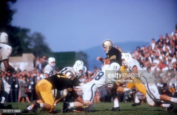 Bob Anderson of the Army Cadets runs with the ball as Maury Schleicher and Andy Stynchula of the Penn State Nittany Lions go for the tackle during an...