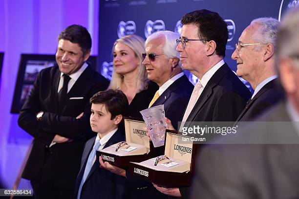 Bob Baffert and Lord Teddy Grimthorpe receive the Longines World's Best Horse Award from Mr JuanCarlos Capelli Vice President of Longines and Head of...