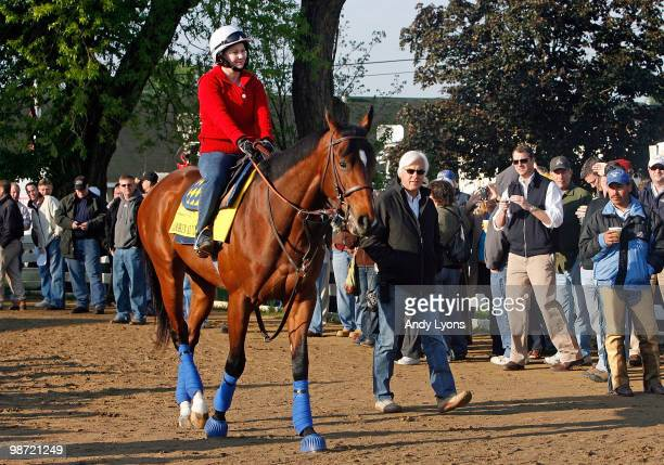 Bob Baffert the trainer of Lookin at Lucky walks beside the horse during the morning workouts for the Kentucky Derby at Churchill Downs on April 28,...