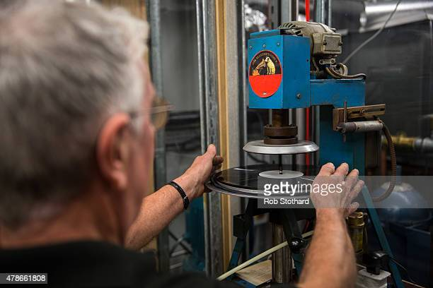 Bob Bailey, a technician from The Vinyl Factory Press, demonstrates the pressing of vinyl at the 'Station to Station: A 30 Day Happening' opening...