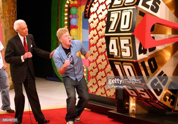 Bob Barker looks on as a contestant takes part in a game during the taping of the 34th season premiere of The Price is Right at CBS Television City...