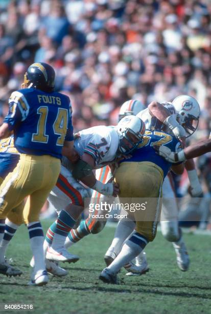 Bob Baumhower of the Miami Dolphins rushes quarterback Dan Fouts of the San Diego Charger during the AFC Divisional Playoff Game game January 16 1983...